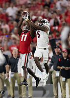 ATHENS, GA - SEPTEMBER 18: Josh Vann #6 successfully fights for the ball against Derion Kendrick #11 during a game between South Carolina Gamecocks and Georgia Bulldogs at Sanford Stadium on September 18, 2021 in Athens, Georgia.