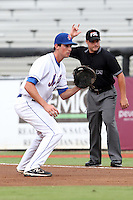 St. Lucie Mets first baseman Stefan Welch #22 makes a play in front of umpire Nick Mahrley during a game against the Charlotte Stone Crabs at Digital Domain Ballpark on June 20, 2011 in Port St Lucie, Florida.  St. Lucie defeated Charlotte 3-2 in 11 innings.  (Mike Janes/Four Seam Images)