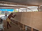 A local i-Kiribati building a traditional boat on the island of Kiritimati in Kiribati