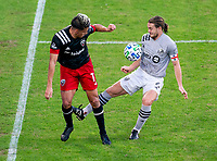WASHINGTON, DC - NOVEMBER 8: Yamil Asad #11 of D.C. United back heels the ball into Samuel Piette #6 of the Montreal Impact during a game between Montreal Impact and D.C. United at Audi Field on November 8, 2020 in Washington, DC.