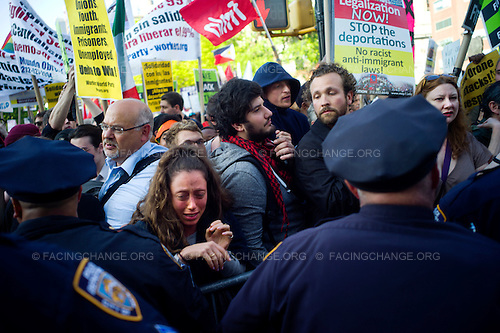 New York, New York.May 1, 2012..A woman demonstrator under stress as police push back the crowd in Union Square...Approximately 20,000 people gathered to celebrate May Day, the International Labor Day, and to protest economic inequality as part of the Occupy Wall Street movement.