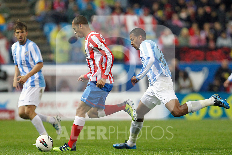 Atletico de Madrid's Miranda (c) and Malaga's Nacho Monreal and Jose Salomon Rondon (r) during La Liga match. Mayo 5,2012. (ALTERPHOTOS/Arnedo & Alconada)