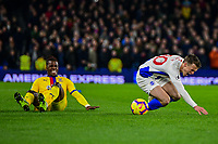 Solly March of Brighton & Hove Albion (20) is fouled buy Wilfried Zaha of Crystal Palace ,during the Premier League match between Brighton and Hove Albion and Crystal Palace at the American Express Community Stadium, Brighton and Hove, England on 4 December 2018. Photo by Edward Thomas / PRiME Media Images.