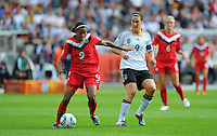 Birgit Prinz (r) of Germany and Candace Chapman of Canada during the FIFA Women's World Cup at the FIFA Stadium in Berlin, Germany on June 26th, 2011.