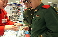 Army officers shop for designer watches in Changsha, Hunan.  .17-JAN-03