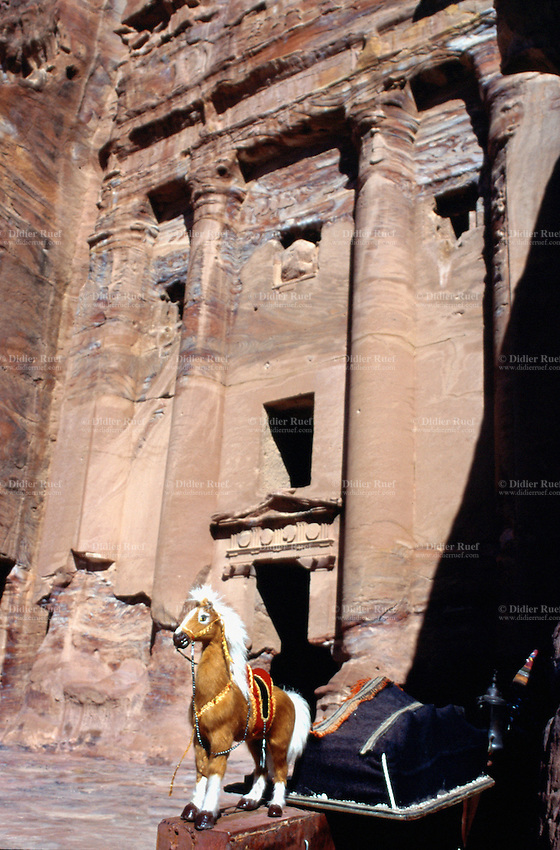 """Jordan. Petra. The archeological site is part of the UNESCO world heritage project.  The Nabataeans were an arabian industrious tribe which settled down in southern Jordan 2000 years ago. Petra is located at the bottom of a spectacular deep gorge surrounded by mountains. """"Urnel Florentius"""" tomb. small shop whare are sold various souvenirs to tourists.  © 2002 Didier Ruef"""