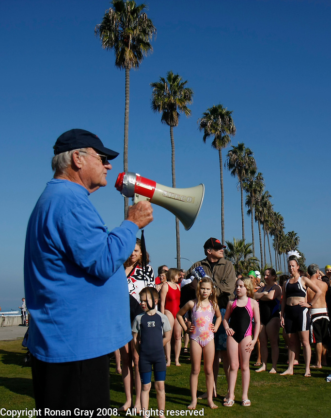 January 1st, 2009.  La Jolla Shores, CA, USA.  Hundreds of swimmers listen as Bob West gives a briefing for the 32nd Annual La Jolla Swim Club's traditional New Years Day Polar Bear Swim near the Lifeguard Tower in La Jolla Shores.  Participants ranged in age from Clara Cohen (9) and Shelby Salyer (10) of Temecula (center foreground) to 90-year old Bob Benzwi, the oldest member of the club (not shown here).