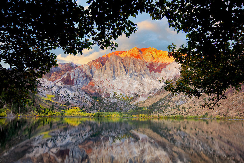Sunrise of Convict Lake with fall colored aspens. California