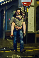 Saturday 21 December 2013<br /> Pictured: A girl is given a lift by her fella in  Lammas Street in Carmarthen, Wales<br /> Re: Black Friday Drinkers