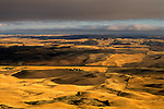Rolling hills of croplands and farm houses at sunset from Steptoe Butte Eastern Washington State USA
