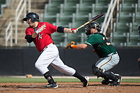 Jake Burger (31) of the Kannapolis Intimidators follows through on his swing against the Greensboro Grasshoppers at Kannapolis Intimidators Stadium on August 13, 2017 in Kannapolis, North Carolina.  The Grasshoppers defeated the Intimidators 4-1 in 10 innings in the completion of a game suspended on August 12, 2017.  (Brian Westerholt/Four Seam Images)