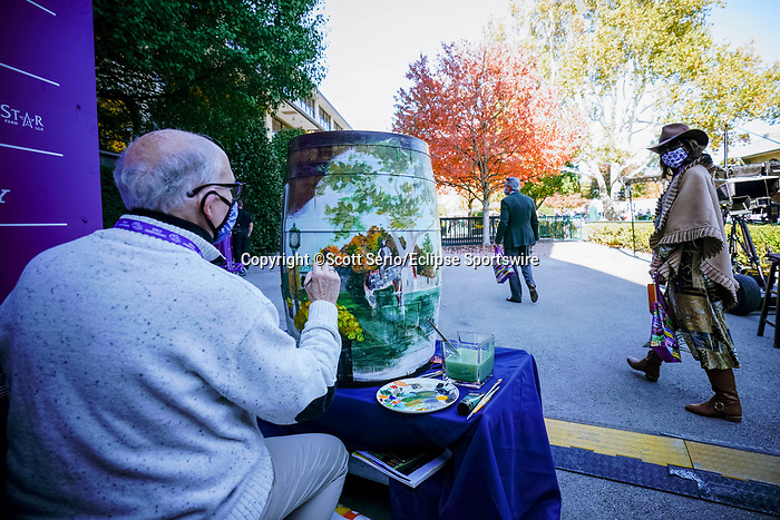 November 6, 2020: An artist paints a fall scene on a barrel in the paddock at Keeneland Racetrack in Lexington, Kentucky, on Friday, November 6, 2020. Scott Serio/Eclipse Sportswire/Breeders Cup/CSM