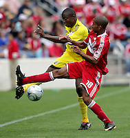 Chicago Fire defender Mike Banner (18) attempts to block a kick by Columbus Crew midfielder Emmaneul Ekpo (17).  The Columbus Crew tied the Chicago Fire 2-2 at Toyota Park in Bridgeview, IL on September 20, 2009.