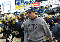 Pitt head coach Paul Chryst leads his team onto the field. The Miami Hurricanes defeated the Pitt Panthers 41-31 at Heinz Field, Pittsburgh, Pennsylvania on November 29, 2013.