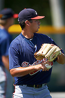 GCL Braves relief pitcher Anthony Guardado (61) throws in the outfield before a game against the GCL Pirates on August 10, 2016 at Pirate City in Bradenton, Florida.  GCL Braves defeated the GCL Pirates 5-1.  (Mike Janes/Four Seam Images)