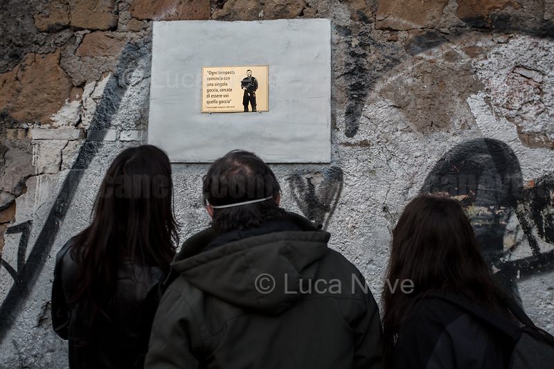 """Lorenzo """"Orso"""" Orsetti's Family. <br /> <br /> Rome, Italy. 23rd Apr, 2021. Today, Azione Antifascista Roma Est, supported by ANPI (Associazione Nazionale Partigiani d'Italia ANPI - National Association of Italian Partizans, Members of the Italian Resistance in WWII) Centocelle and the Kurdish Community (Rete Kurdistan Roma and Ararat Kurdish Cultural Centre), held a demonstration (1.) to commemorate the second anniversary of the death of Lorenzo """"Orso"""" Orsetti, the Italian citizen who died the 18th of March 2019 in the North of Syria / Rojava while fighting against ISIS along with the Kurdish forces. At the end of the demo a memorial plaque was installed in Camelie's Square which says: """"Ogni tempesta comincia con una singola goccia. Cercate di essere voi quella goccia"""" (Every storm begins with a single drop. Try to be that drop). <br /> <br /> Footnotes & Links:<br /> 1. http://bit.do/fQAAU <br /> (Source, Wikipedia.org ENG) https://en.wikipedia.org/wiki/Lorenzo_Orsetti"""