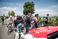 The 15th stage came to an abrupt halt after just a few minutes (3km) of racing following a large crash that forced the race to temporarily be neutralized as medical assistence was temporarily stretched to the max. <br /> Gianni Vermeersch (BEL/Alpecin-Fenix) and Tony Gallopin (FRA/AG2R Citroën) getting some medical assistance where their surface wounds are treated.<br /> <br /> <br /> 104th Giro d'Italia 2021 (2.UWT)<br /> Stage 15 from Grado to Gorizia (147km)<br /> <br /> ©kramon