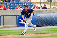 Bryce Harper #34 of the Hagerstown Suns takes his lead off of third base against the Rome Braves at State Mutual Stadium on May 1, 2011 in Rome, Georgia.   Photo by Brian Westerholt / Four Seam Images