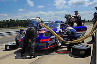 17-19  July, 2009, Birmingham, Alabama USA.The #65 Rigel/Stanton TRG Porsche GT3 John Potter & Craig Stanton makes a pit stop..©2009 F.Peirce Williams, USA.