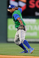 Second baseman Carlos Garcia (6) of the Lexington Legends throws out a runner in a game against the Greenville Drive on Thursday, April 24, 2014, at Fluor Field at the West End in Greenville, South Carolina. Greenville won, 9-4. (Tom Priddy/Four Seam Images)
