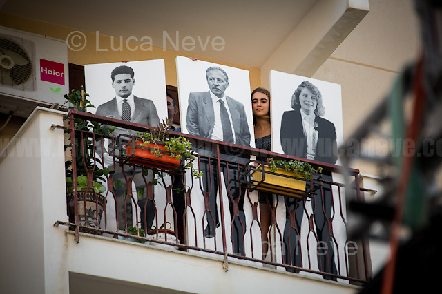 """Balcony of Borsellino's Family: Paolo Borsellino, Agostino Catalano, Emanuela Loi, Vincenzo Li Muli, Walter Eddie Cosina and Claudio Traina, finally arrived at home...<br /> <br /> Palermo (Sicily - Italy), 19/07/2017. """"Basta depistaggi e omertà di Stato!"""" (""""Stop disinformation & omertá by the State!"""")(1). Public event to commemorate the 25th Anniversary of the assassination of the anti-mafia Magistrate Paolo Borsellino along with five of his police """"scorta"""" (Escorts from the special branch of the Italian police force who protect Judges): Agostino Catalano, Emanuela Loi (The first Italian female member of the police special branch and the first woman of this branch to be killed on duty), Vincenzo Li Muli, Walter Eddie Cosina and Claudio Traina. The event was held at Via D'Amelio, the road where Borsellino was killed. Family members of mafia victims, amongst others, made speeches about their dramatic experiences, mafia violence and unpunished crimes, State cover-ups, silence ('omertá'), and misinformation. Speakers included, amongst others, Vincenzo Agostino & Augusta Schiera, Salvatore & Cristina Catalano, Graziella Accetta, Massimo Sole, Paola Caccia, Luciano Traina, Angela Manca, Stefano Mormile, Ferdinando Imposimato, Judge Nino Di Matteo. The event ended with the screening of the RAI docu-fiction, 'Adesso Tocca A Me' ('Now it's My Turn' - Watch it here: http://bit.ly/2w3WJUX ).<br /> <br /> For more info & a video of the event please click here: http://bit.ly/2eQfNT3 & http://bit.ly/2eQbmrj & http://19luglio1992.com & http://bit.ly/2he8hCj<br /> <br /> (1) 'Omerta' is the term used in Italy to refer to the code of silence used by mafia organisations, as well as the culture of silence that is entrenched in society at large (especially among victims of mafia crimes, as they fear recriminations), about the existence of organised crime and its activities."""