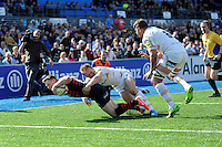 Chris Ashton of Saracens forces his way over in the corner despite the efforts of Chris Pennell of Worcester Warriors during the Aviva Premiership match between Saracens and Worcester Warriors at Allianz Park on Saturday 3rd May 2014 (Photo by Rob Munro)