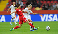 Katie Hoyle (r) of team New Zealand and Karen Carney of team England during the FIFA Women's World Cup at the FIFA Stadium in Dresden, Germany on July 1st, 2011.