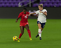 ORLANDO CITY, FL - FEBRUARY 18: Nichelle Prince #15 fights off Abby Dahlkemper #7 during a game between Canada and USWNT at Exploria stadium on February 18, 2021 in Orlando City, Florida.