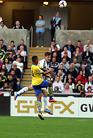 Saturday 28 September 2013<br /> Pictured L-R:Serge Gnabry of Arsenal against Ben Davies of Swansea <br /> Re: Barclay's Premier League, Swansea City FC v Arsenal at the Liberty Stadium, south Wales.