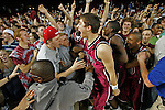 WAKEFIELD5.SP.031106.EDR.JPG   Wakefield's Tim Adleman (24) celebrates with teammates and the Wakefield fans after winning th 4A State Championship over North Mecklenburg 45-43 at Reynolds Coliseum on Saturday, March 11, 2006.   staff/Ted Richardson