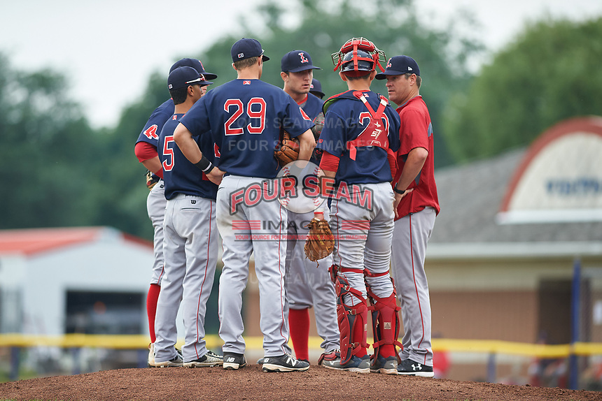 Lowell Spinners pitching coach Lance Carter (right) talks with starting pitcher Nick Duron (center) and infielders Brett Netzer (hidden), Juan Barriento (hidden), Yomar Valentin (5), Michael Osinski (29), as well as catcher Samuel Miranda (20) during a game against the Batavia Muckdogs on July 12, 2017 at Dwyer Stadium in Batavia, New York.  Batavia defeated Lowell 7-2.  (Mike Janes/Four Seam Images)