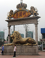 The entrace to Holland Village is guarded by huge golden lions. Holland Village, a 220-hectare re-creation of a Dutch city on the outskirts of Shenyang lies in ruins as a monument to corruption in China. Yang Bing, a Dutch passport, got hooked on Holland while studying at Leiden University. Yang bing who built the village with some of ill gotten billions now languishes in jail and the town that is composed of several monumental buildings, plus windmills, artificial lakes, canal a fullsize scooner, 1400 luxury apartments and even an indoor beach are rotting. (see text for more information)