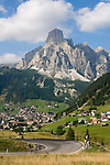 Italy, South Tyrol, Alto Adige, Dolomites, Corvara in Badia with Puez mountains, cyclists