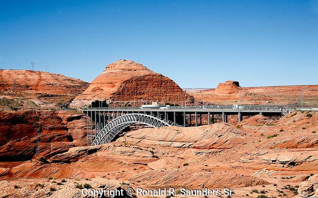 Steel arch bridge spans Glen Canyon.