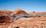 Steel arch bridge spans Glen Canyon.
