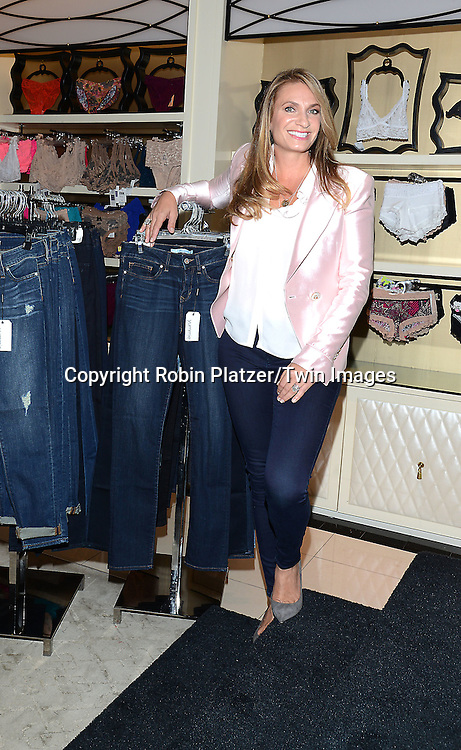 Heather Thomson Introduces her new denim and acitve collections called Yummie  by Heather Thomson at Bloomingdales in New York City on September 11, 2014.<br /> <br /> photo by Robin Platzer/Twin Images<br />  <br /> phone number 212-935-0770