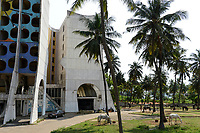 TOGO, Lome, since 2005 abandoned Hotel de la Paix at Boulevard du Mono, built in 1970`íes and managed by Pullman group, in front grazing beach horses / verlassenenes Hotel des Friedens, davor grasende Strandpferde