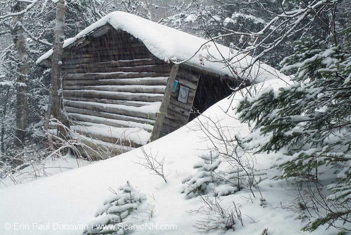 Resolution Shelter during a snow storm. Located off Davis Path in the Dry River Wilderness in the White Mountains, New Hampshire USA. The Resolution shelter was an Adirondack-style shelter that was closed in 2009 because of safety issues. It was torn down in December of 2011.
