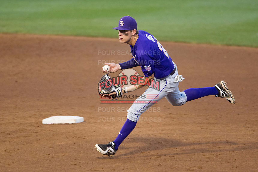 LSU Tigers second baseman Jacoby Jones (23) makes a tough play against the Texas A&M Aggies in the NCAA Southeastern Conference baseball game on May 10, 2013 at Blue Bell Park in College Station, Texas. LSU defeated Texas A&M 7-4. (Andrew Woolley/Four Seam Images).