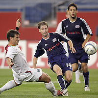 The Revolution's Steve Ralston beats Jeff Agoos of the MetroStars to score the game winning goal. The New England Revolution defeated the MetroStars 4 to 2 at Gillette Stadium, Foxbourgh, MA, on June 25, 2005.