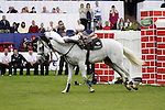 August 08, 2009: Alex Duffy (IRL) holds onto his mount Courtown after crashing through the wall. Land Rover International Puissance. Failte Ireland Horse Show. The RDS, Dublin, Ireland.