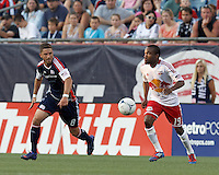 New York Red Bulls forward Dane Richards (19) controls the ball as New England Revolution defender Chris Tierney (8) closes. In a Major League Soccer (MLS) match, New England Revolution defeated New York Red Bulls, 2-0, at Gillette Stadium on July 8, 2012.