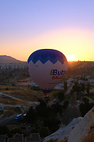 Hot air balloon fly in the morning over rising sun, Cappadocia, Turkey