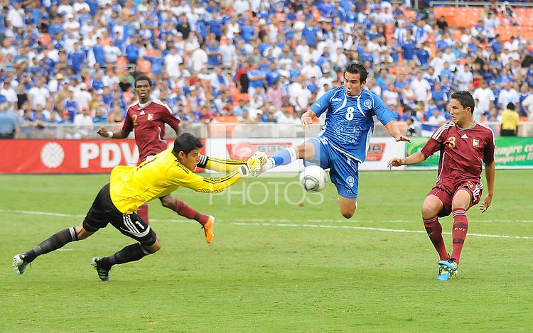 Venezuela goal keeper Rafael Romo (1)  defends the play against El Salvador forward Rafael Burgos (8). El Salvador National Team defeated Venezuela 3-2 in an international friendly at RFK Stadium, Sunday August 7, 2011.