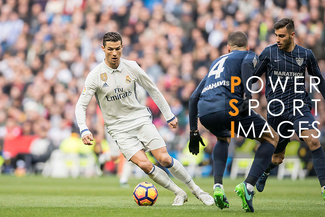 Cristiano Ronaldo (l) of Real Madrid competes for the ball with Mikel Villanueva of Malaga CF during their La Liga 2016-17 match between Real Madrid and Malaga CF at the Estadio Santiago Bernabéu on 21 January 2017 in Madrid, Spain. Photo by Diego Gonzalez Souto / Power Sport Images