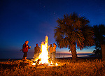 Residents of Shell Point gather for a beach fire after the Christmas Lighted Boat Parade