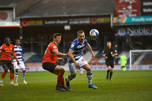 21st April 2021; Kenilworth Road, Luton, Bedfordshire, England; English Football League Championship Football, Luton Town versus Reading; George Puscas of Reading challenges for the ball with Matty Pearson of Luton Town.