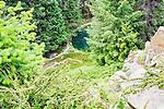 Hidden pond in  alpine botanical garden.  Ohme Gardens, Wenatchee, Chelan County, Washington, USA.