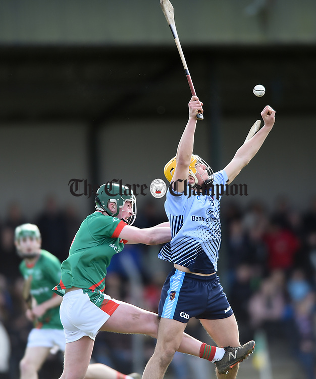 Mark Rodgers of Scariff Community College in action against Niall Coss of St Fergal's College during their All-Ireland Colleges final at Toomevara. Photograph by John Kelly.