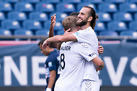 FOXBOROUGH, MA - JULY 4: Marios Lomis #9 of Greenville Triumph SC celebrates his third goal of the game during a game between Greenville Triumph SC and New England Revolution II at Gillette Stadium on July 4, 2021 in Foxborough, Massachusetts.